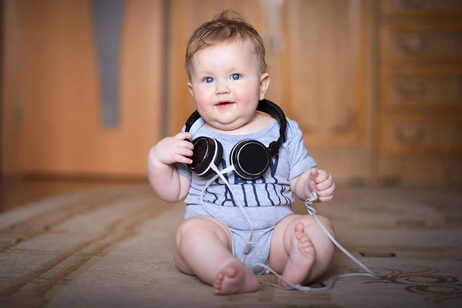 500px Photo ID: 152637663 - My little boy playing with headphones